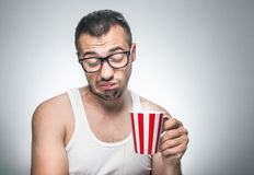 Displeased man with cup coffee. Nerd does not want to drink, isolated on gray background stock images