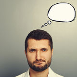 Displeased man with drawing speech bubble Stock Image