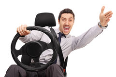 Displeased man driving and arguing. Displeased young man driving and arguing with someone isolated on white background Royalty Free Stock Image