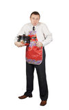 Displeased man holds a pan and a ladle Royalty Free Stock Photos