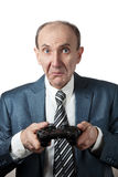 Displeased Man with joypad. Displeased Businessman with joypad pushing the button at white background Royalty Free Stock Photography