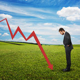 Displeased man looking at re graph Stock Image