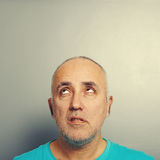 Displeased man looking up Royalty Free Stock Image