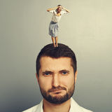 Displeased man with screaming woman. Displeased men with screaming women over grey background Royalty Free Stock Images