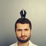 Displeased man with small boss on the head Stock Photo