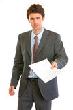 Displeased modern businessman showing document Stock Images