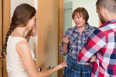 Displeased neighbors arguing in the doorway Royalty Free Stock Image