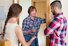 Displeased neighbours arguing in the doorway Stock Photography