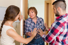 Displeased neighbours arguing in the doorway Royalty Free Stock Photography