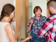 Displeased neighbours arguing in the doorway Stock Photos