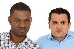Displeased pissed off angry grumpy men Royalty Free Stock Images