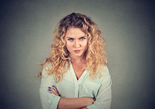 Displeased pissed off angry grumpy pessimistic woman with bad attitude. Arms crossed looking at you Negative human emotion facial expression feeling Stock Image