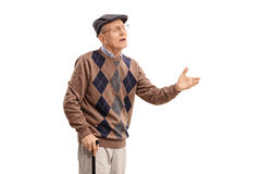 Displeased senior arguing with someone Royalty Free Stock Photos