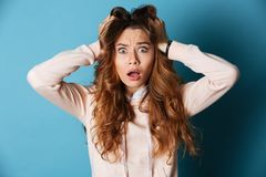 Displeased shocked young woman standing isolated Royalty Free Stock Photos