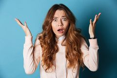 Displeased shocked young woman standing isolated Royalty Free Stock Images