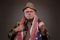 Displeased Vietnam Veteran with American flag Royalty Free Stock Photo