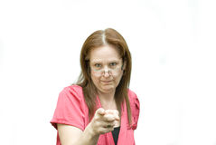 Displeased woman pointing. Royalty Free Stock Images