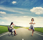 Displeased woman and smiley yoga woman Stock Photo
