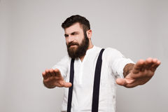 Displeased young handsome man refuse over white background. Stock Image