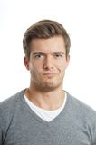 Displeased young man Royalty Free Stock Images