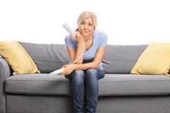 Displeased young woman holding a telephone speaker stock photos