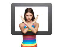 Displeased young woman peeping out of tablet frame Royalty Free Stock Photo