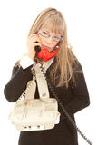 Displeasured woman with telephones Stock Photo