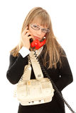 Displeasured woman with telephones Royalty Free Stock Photo