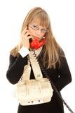 Displeasured woman with telephones Royalty Free Stock Photo