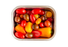 Disposable Aluminum Foil Grilling Tray with Vegetables. Disposable Aluminum foil grilling tray with an assortment of cherry tomatoes and small peppers ready for royalty free stock images