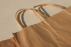 Disposable bags of kraft paper isolated, eco style living, ecological and economical pacaging stock image