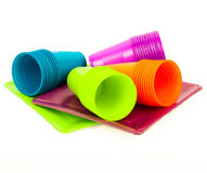 Disposable bright plastic cups and plates stacked stock image