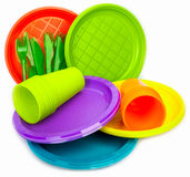 Disposable bright plastic dishes stacked on white Stock Photo