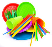 Disposable bright plastic kitchenware stacked on white Royalty Free Stock Images