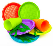 Disposable bright plastic kitchenware stacked on white Stock Photos