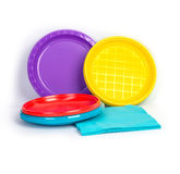 Disposable bright plastic plates and napkins isolated on white background Royalty Free Stock Photo