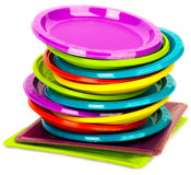 Disposable bright plastic plates stacked. Disposable plastic plates stacked on white Stock Image