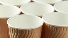 Disposable brown paper takeaway coffee tea cups.  royalty free stock image