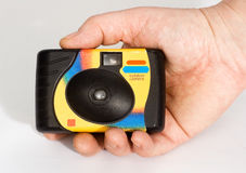 A disposable camera in hand, photographer Stock Images