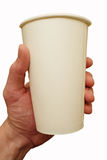 The disposable cardboard cup in hand Stock Image