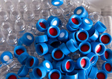 Disposable chemistry caps and bottles. Disposable caps and bottles for chromatography chemistry experiments and tests Stock Image