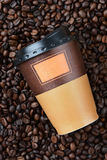 Disposable Coffee Cup on Beans Royalty Free Stock Photo