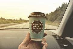 Disposable coffee cup in car