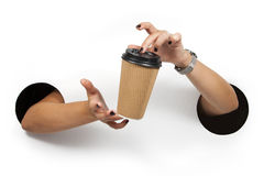 Disposable coffee cup in female hands. Stock Photography