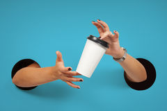Disposable coffee cup in female hands Stock Photography