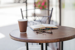 Disposable coffee cup on table Royalty Free Stock Image