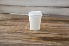 Disposable coffee cup on wooden table Stock Photo