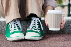 Disposable coffee cup. Young woman drinking coffee from disposable cup Royalty Free Stock Images