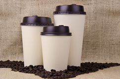 Disposable coffee cups. Three disposable coffee cups with plastic lid Royalty Free Stock Photo