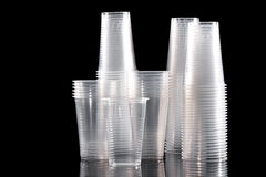 Disposable cup. S on black backgound with reflection Royalty Free Stock Photo